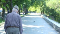 An old man walks along the street of Odessa Stock Footage