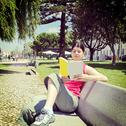 Stock Photo of woman reading book in park.