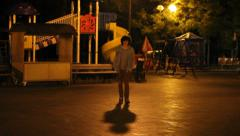 A playground at night and  teenager Stock Footage