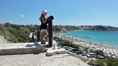 Small child a girl standing on observation deck, Coral Bay, Paphos, Cyprus Stock Footage