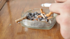 Smoker Lightly Placing Cigarette Ashes on Ashtray Stock Video - stock footage