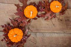 pumkins and fall leaves for decoration - stock photo