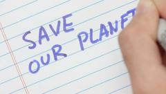 SAVE OUR PLANET  - Writing On Paper Stock Footage