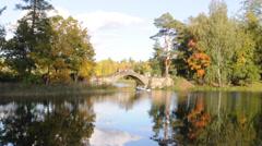 Humpbacked (Gorbaty) bridge at White (Beloye) lake. Gatchina, Russia Stock Footage