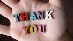 THANK YOU - Word Appearing In Hand Stock Footage