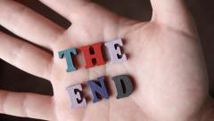 THE END - Word Appearing In Hand - stock footage