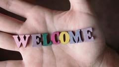 WELCOME - Word Appearing In Hand - stock footage