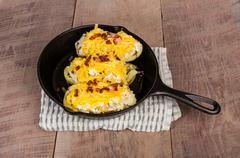 twice baked potatoes in skillet - stock photo