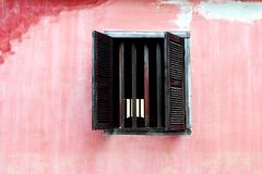 window from a old house on pink wall,vietnam - stock photo