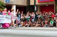 Stock Photo of hundreds of spectators watch dragon con parade on atlanta street