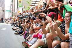 spectators pack street watching dragon con parade in atlanta - stock photo