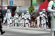 Stock Photo of star wars storm troopers walk in atlanta dragon con parade