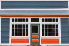 Small store front entrance colorful wooden house Stock Photos