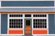 Stock Photo of small store front entrance colorful wooden house