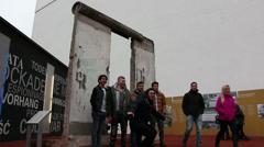Teenagers visiting berlin wall Stock Footage