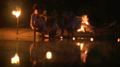 Girl in a wreath of flowers at night let the candle on the river Stock Footage