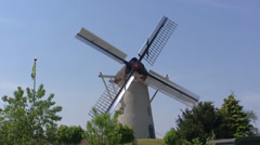 Dutch Windmill milling with open sails and Ten have sails with shutters - stock footage