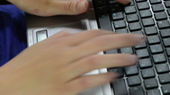 Closeup of laptop computer keyboard and hands working with it Stock Footage
