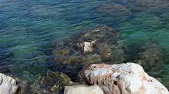 Mediterranean sea water splashing around reefs, Cyprus island Stock Footage