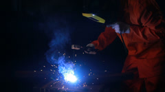 Welder working in a mask Stock Footage