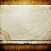 Vintage paper card on wooden texture - stock illustration
