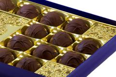chocolate sweets in the box on the white background. - stock photo