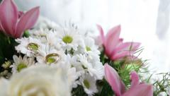 A wedding rings on the flowers Stock Footage