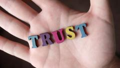 TRUST - Word Appearing In Hand Stock Footage