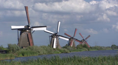 Row of windmills at Kinderdijk turning, pumping Stock Footage