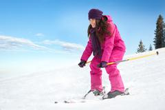 young woman skiing - stock photo