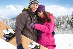 Stock Photo of affectionate couple on winter holiday