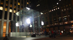 Entrance to Apple retail store with people in New York - stock footage