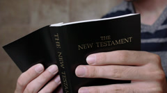 Young Man Reading The Christian Bible Stock Footage