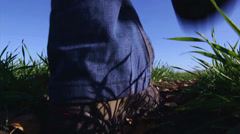 The person goes on road with the fallen down leaves Stock Footage