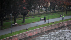 Stock Video Footage of Evening jog in Frankfurt near Rhein