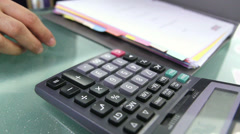 Businessman using a calculator - stock footage