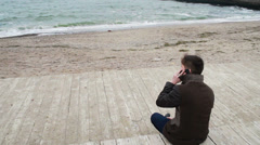 Lonely man on the beach in autumn Stock Footage