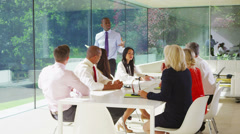 Business team meeting in light contemporary office with natural outdoor views - stock footage
