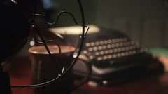 Rack focus from fan to typewriter Stock Footage