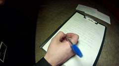 A convicted criminal writes a letter - stock footage