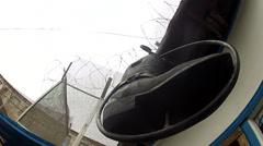 Suspended boots over the door Shoe repair Stock Footage