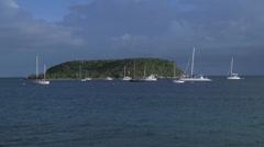 Sailboat wideshot island Stock Footage