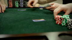 Adults playing poker card game Stock Footage