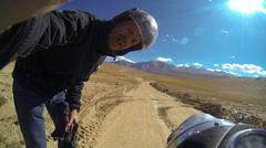 Selfi motorbike rider Khardung Pass, Ladakh, India                               Stock Footage