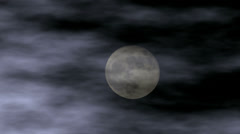 Full moon in clouds Stock Footage
