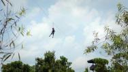 Stock Video Footage of Boy riding a zip line