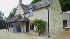 Exterior view of a traditional English cottage with contemporary built extension Stock Footage