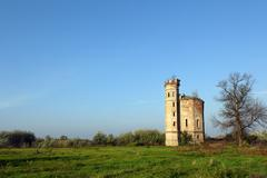 Old ruined castle with tower landscape Stock Photos