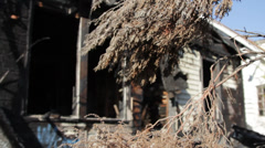 Approaching an abandoned, burned out house in Detroit (HD) k Stock Footage