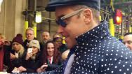 Stock Video Footage of Singer Robbie Williams Signing Autographs And Chatting
